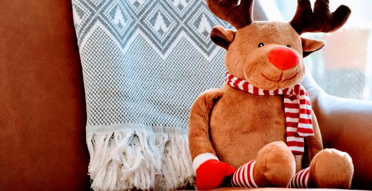 reindeer toy sat on sofa