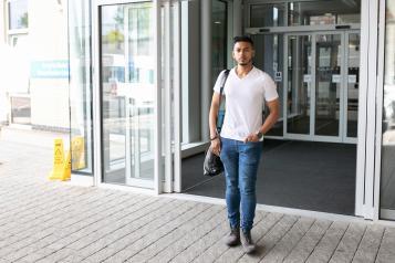 Man walking outside A&E