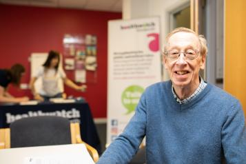 gentleman smiling for a photo at a healthwatch event