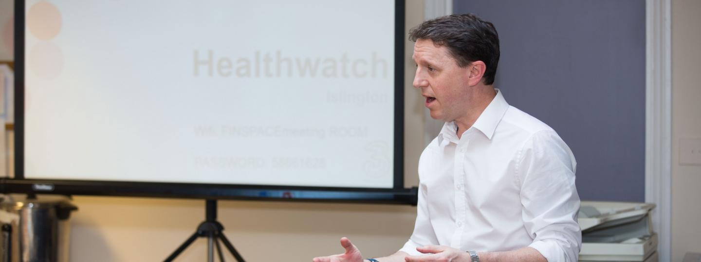 Healthwatch people talk at a meeting