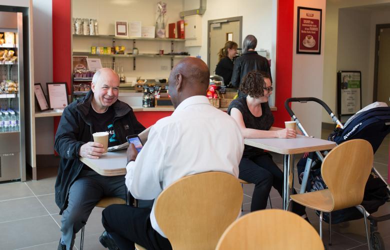 Men talking in cafe